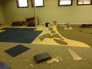 3 kinds of carpeting being installed in the children's area